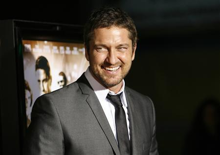 Cast member Gerard Butler attends the premiere of the movie ''RocknRolla'' at the Cinerama Dome in Hollywood, California October 6, 2008. The movie opens in the U.S. on October 31. REUTERS/Mario Anzuoni