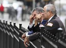 <p>Traders sit outside the New York Stock Exchange, October 8, 2008. REUTERS/Brendan McDermid</p>