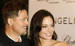 "<p>Actors Brad Pitt and Angelina Jolie arrive for the New York Film Festival premiere of ""Changeling"" in New York October 4, 2008. REUTERS/Lucas Jackson</p>"