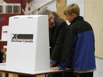 <p>Conservative leader and Canada's Prime Minister Stephen Harper talks with his son Ben as he marks his ballot in Calgary, Alberta October 14, 2008. REUTERS/Chris Wattie</p>