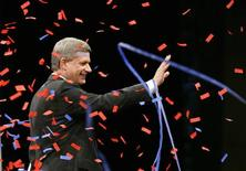 <p>Conservative Party leader and Canadian Prime Minister Stephen Harper waves to supporters at his election night headquarters in Calgary, Alberta October 14, 2008. REUTERS/Todd Korol</p>