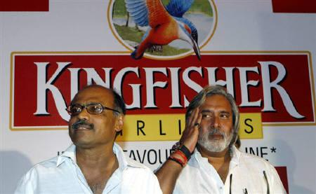 Vijay Mallya (R) and G. R. Gopinath, are seen in Mumbai in this June 1, 2007 file photo. Kingfisher Airlines Ltd Vice Chairman G.R. Gopinath said on Wednesday he is interested in buying back the budget airline of Kingfisher if Chairman Vijay Mallya exits the low-cost carrier model. REUTERS/Stringer