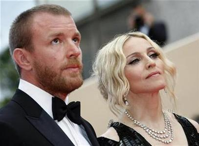 Madonna and husband Guy Ritchie arrive on the red carpet at the 61st Cannes Film Festival, May 21, 2008. REUTERS/Eric Gaillard