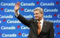 <p>Conservative Party leader and Canadian Prime Minister Stephen Harper gestures to supporters at his election night headquarters in Calgary, October 14, 2008. REUTERS/Chris Wattie</p>