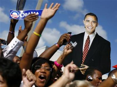 Supporters of Democratic presidential nominee Senator Barack Obama hold up a cardboard cutout of Obama at a campaign event at the Palm Beach Community College in Lake Worth, Florida, October 21, 2008. REUTERS/Jim Young