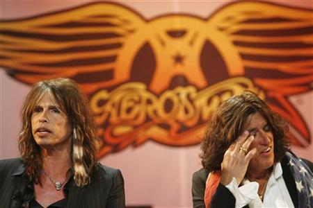 Aerosmith's Steven Tyler (L) and Joe Perry attend a press conference for the new video game ''Guitar Hero: Aerosmith'' in New York, June 27, 2008. REUTERS/Lucas Jackson
