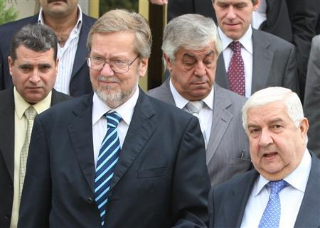 Syrian Foreign Minister Walid al-Moualem (R) walks with his Danish counterpart Per Stig Moller (front L) after a meeting in Damascus October 26, 2008. REUTERS/Khaled al-Hariri