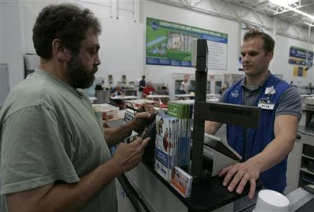 A customer pays for his items at a Sam's Club in Fayetteville, Arkansas June 5, 2008. REUTERS/Jessica Rinaldi