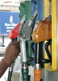 An Indian worker lifts a petrol nozzle at a petrol pump in New Delhi March 24, 2005. Emerging markets such as China and India could make up for declining oil demand from developed countries and may be the cause for demand growth in 2009, the International Energy Agency's chief economist said on Thursday. REUTERS/B Mathur/Files
