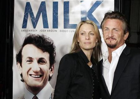 Cast member Sean Penn and his wife, actress Robin Wright Penn, pose for photographers as they arrive for the world premiere of the film ''Milk,'' at the Castro Theatre in San Francisco, California October 28, 2008 REUTERS/Robert Galbraith