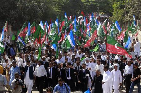 Lawyers and supporters of political parties attend a protest rally on the first anniversary of the imposition of emergency rule by then president Pervez Musharraf in Karachi, November 3, 2008. REUTERS/Athar Hussain