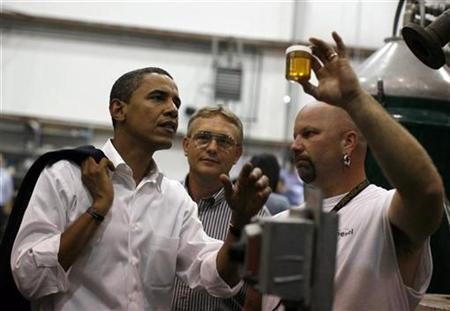Democratic presidential nominee Senator Barack Obama looks at a sample of bio diesel fuel during a tour of the Pennsylvania Bio Diesel Plant in Monaca, Pennsylvania, August 29, 2008. REUTERS/Jim Young