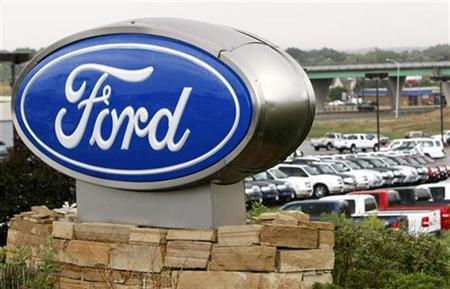 The sign outside a Ford dealership in Broomfield, Colorado, July 23, 2008. REUTERS/Rick Wilking