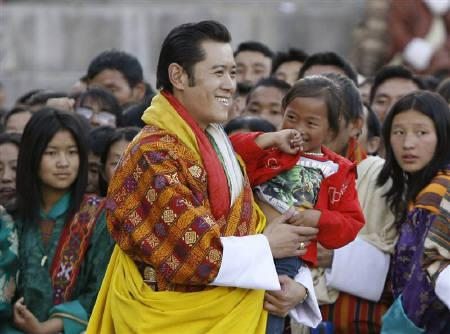 Bhutan's King Jigme Khesar Namgyel Wangchuck carries a child in the courtyard of Tashichhodzong Palace during celebrations marking his coronation ceremony in Thimphu November 6, 2008. REUTERS/Desmond Boylan