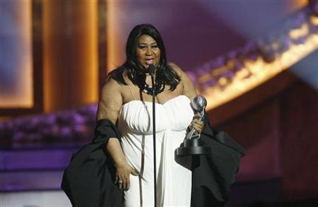 Singer Aretha Franklin accepts the Vanguard Award at the 39th Annual NAACP Image Awards at the Shrine auditorium in Los Angeles February 14, 2008. REUTERS/Mario Anzuoni