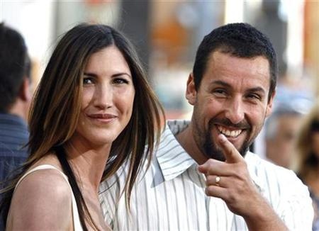 Cast member Adam Sandler gestures next to his wife Jackie at the premiere of ''I Now Pronounce You Chuck and Larry'' at the Gibson amphitheater in Universal City, California July 12, 2007 .REUTERS/Mario Anzuoni