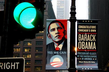 A sign of congratulations hangs on a lamppost outside the Kluczynski Federal Office Building which houses President-elect Barack Obama's transition office in downtown Chicago, November 12, 2008. REUTERS/Kevin Lamarque
