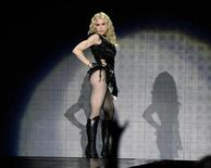 "<p>U.S. singer Madonna performs on stage during her ""Sticky and Sweet"" tour at the Danube island in Vienna September 23, 2008. REUTERS/Leonhard Foeger</p>"