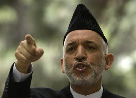 Afghan President Hamid Karzai speaks at a news conference in Kabul in this June 15, 2008 file photo. REUTERS/Ahmad Masood/Files