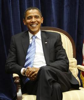 President-elect Barack Obama smiles during a meeting in his transition office in Chicago, November 17, 2008. REUTERS/John Gress