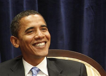 President-elect Barack Obama smiles during a meeting in Obama's transition office in Chicago, November 17, 2008. REUTERS/John Gress