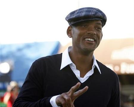 Will Smith gestures at the premiere of ''Madagascar: Escape 2 Africa'' at the Mann Village theatre in Westwood, California October 26, 2008. REUTERS/Mario Anzuoni
