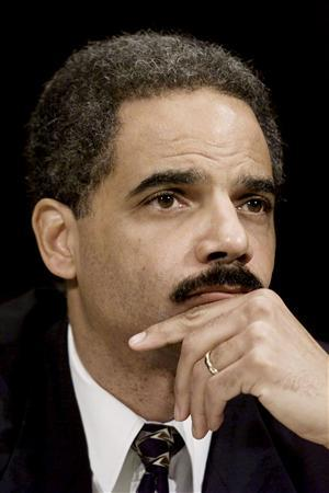 Eric Holder, former Deputy Attorney General at the U.S. Department of Justice, listens to questioning in this file image from February 14, 2001. REUTERS/Win McNamee/Files