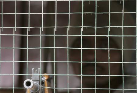 A policeman stands guard inside a security post in Srinagar in this November 17, 2008 file photo. REUTERS/Danish Ismail