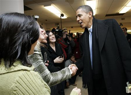 President-elect Barack Obama shakes hands with customers after ordering lunch at Manny's Coffee Shop and Deli in Chicago, Illinois November 21, 2008. REUTERS/Frank Polich