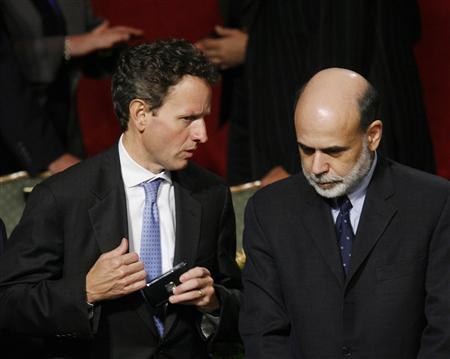 Federal Reserve Chairman Ben Bernanke (R) nods as he listens to President of the Federal Reserve Bank of New York Timothy Geithner before addressing the Economic Club of New York in this October 15, 2008 file photo. REUTERS/Lucas Jackson/Files