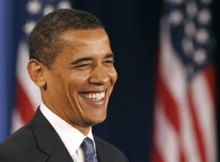 US President-elect Barack Obama smiles during a news conference in Chicago, November 25, 2008. REUTERS/Jeff Haynes