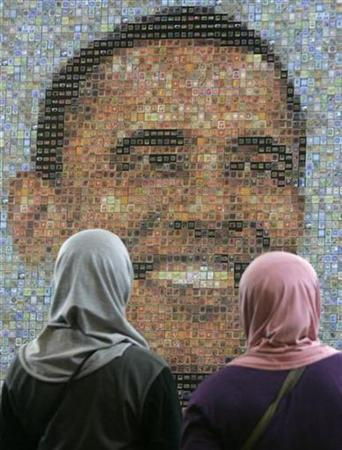 Women look at an image of President-elect Barack Obama, made from a mosaic of stamps, during the Asian International Stamp Exhibition in Jakarta, October 25, 2008. REUTERS/Dadang Tri