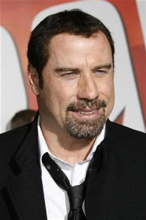 Actor John Travolta poses at the premiere of his animated film ''Bolt'' from Walt Disney Animation Studios in Hollywood November 17, 2008. Travolta provides one of the character voices in the film. REUTERS/Fred Prouser
