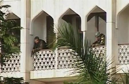 A video grab shows army personnel on a balcony of the Taj Mahal Hotel in Mumbai November 27, 2008. REUTERS/Reuters TV