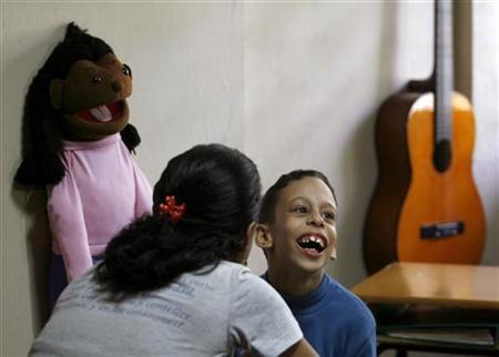 An autistic child attends a music class at the Dora Alonso Center for autistic children in Havana February 11, 2008. REUTERS/Enrique De La Osa