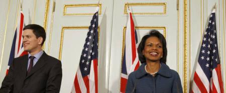 Britain's Foreign Secretary David Miliband (L) and U.S. Secretary of State Condoleezza Rice speak at a news conference after their meeting in London December 1, 2008. Rice on Monday urged Pakistan to give its ''absolute, total'' cooperation in finding those responsible for last week's attacks on Mumbai. REUTERS/Stephen Hird