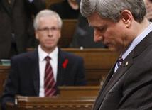 <p>Liberal leader Stephane Dion (L) looks on as Canadian Prime Minister Stephen Harper speaks during Question Period in the House of Commons on Parliament Hill in Ottawa December 1, 2008. REUTERS/Chris Wattie</p>
