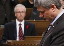 <p>Liberal leader Stephane Dion (L) looks on as Prime Minister Stephen Harper speaks during Question Period in the House of Commons on Parliament Hill in Ottawa December 1, 2008. REUTERS/Chris Wattie</p>