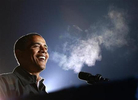 Senator Barack Obama laughs during his remarks in the cold, humid air during his final campaign rally before the U.S. presidential election in Manassas, Virginia, November 3, 2008. REUTERS/Jason Reed
