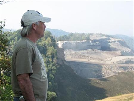 Retired miner Chuck Nelson, 57, surveys a mountaintop removal coal mine on Kayford Mountain, West Virginia in this September 7, 2007 file photo.REUTERS/Andrea Hopkins/Files
