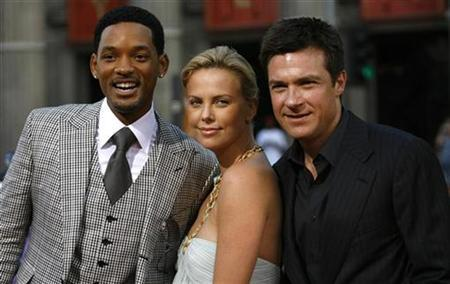 Cast members Will Smith (L), Charlize Theron and Jason Bateman (R) pose at the movie premiere of ''Hancock'' at Grauman's Chinese theatre in Hollywood, California June 30, 2008.REUTERS/Mario Anzuoni