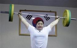 <p>South Korea's national team weightlifter Jang Mi-ran practises during a media day event showing their training session for the Beijing 2008 Olympics at the Korea National Training Centre in Seoul July 9, 2008. REUTERS/Jo Yong-Hak</p>