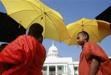 <p>Buddhists monks walk in front of the municipal council building as they proceed to attend an assembly in Colombo, Sri Lanka, October 30, 2008. REUTERS/Buddhika Weerasinghe</p>