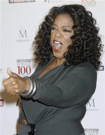 Oprah Winfrey, chairman of Harpo Inc. and host of ''The Oprah Winfrey Show'', gestures as she arrives for a breakfast honoring women in Beverly Hills, California  December 5, 2008. Winfrey was named the most powerful woman in entertainment on The Hollywood Reporter's 17th annual Women in Entertainment: Power 100 list. REUTERS/Fred Prouser