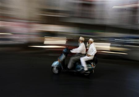 Indian Muslims travel on a scooter in the old quarters of Mumbai December 5, 2008. REUTERS/Arko Datta