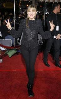 Director of the movie, Catherine Hardwicke, gestures at the premiere of the movie ''Twilight'' at the Mann Village and Bruin theatres in Westwood, California, November 17, 2008. REUTERS/Mario Anzuoni