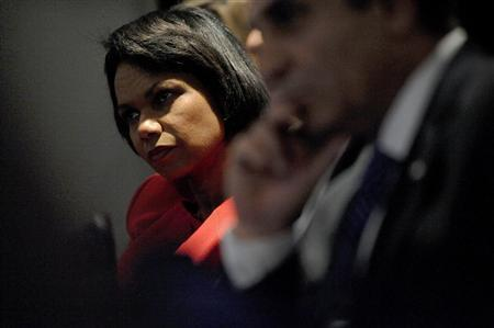 U.S. Secretary of State Condoleezza Rice (L) listens to President George W. Bush make remarks on his Middle East policy to the Saban Forum at the Newseum in Washington December 5, 2008. REUTERS/Jonathan Ernst