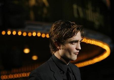 Cast member Robert Pattinson attends the premiere of the movie ''Twilight'' at the Mann Village and Bruin theatres in Westwood, California November 17, 2008. REUTERS/Mario Anzuoni