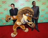 "<p>Actors Ben Stiller (L) and Chris Rock pose with the character ""Alex"" the lion at the State Theatre in Sydney before the Australian premier of their new film ""Madagascar: Escape 2 Africa"", November 17, 2008. REUTERS/Tim Wimborne</p>"