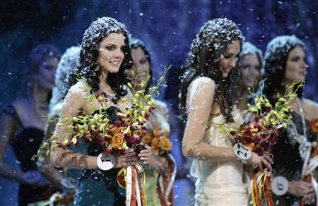 Participants of the ''Miss Russia'' beauty contest are seen covered with artificial snow at the end of the show in Moscow December, 14, 2007. REUTERS/Denis Sinyakov